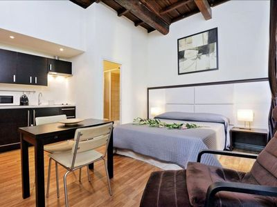 Photo for Spacious Vicolo de' Cinque A  apartment in Trastevere with WiFi & integrated air conditioning.