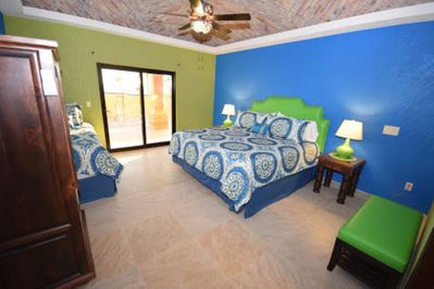 BLUE ROOM WITH A KING BED AND TWIN BED.
