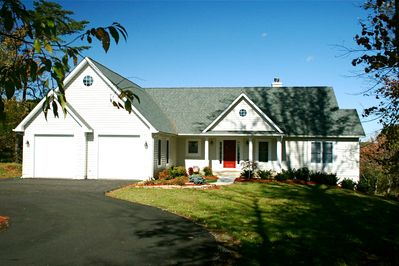 Front of house w/ circular driveway