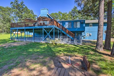 The home sits on 1.8 acres of private land near Bass Lake.