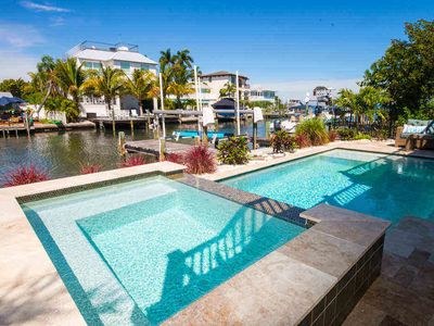 Photo for DONT MISS THE CHANGE TO BOOK YOUR 2020 STAY TODAY!  GORGEOUS CANAL FRONT WITH POOL AND SPA.  ACCESS TO BAY AND WALKING DISTANCE TO GULF BEACHES!! BOAT & KAYAK LAUNCH NEXT TO HOME!