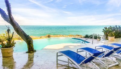Photo for Quiet condo with lovely sea views, Wi-fi, cable TV, pool, A/C, ground floor