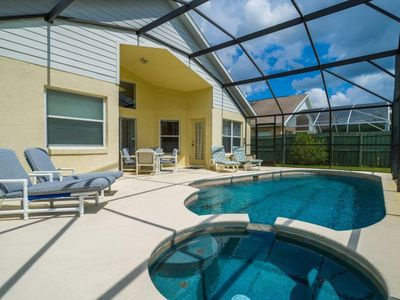 Photo for Deluxe 4 bed 3 bath pool home at the prestigious Indian Creek near Disney, Orlando