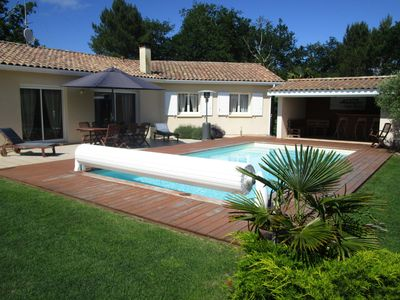 Photo for Quiet heated pool house 10 minutes from the beach with garden