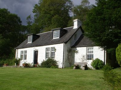 Photo for Dubh Loch Cottage on the banks of Loch Lomond. Large garden and stream