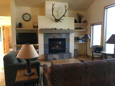 Living room - gas fireplace, mountain views.  Sofa is a queen bed pullout.