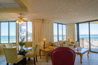 "Relax and enjoy the ocean view from every room in your ""Surfside Sandcastle""."