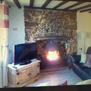 Photo for Holiday Cottage with open fire, close to several sandy beaches