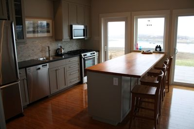Modern kitchen for gourmet cooking with oceanfront view and gas range