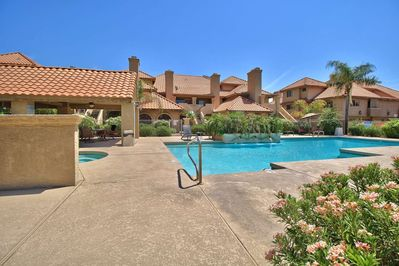 Community Heated Pool and Spa area with gas BBQ Grills