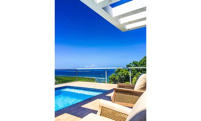 ORGANIC SUNLIGHT POOL AREA WITH LUXURIOUS OCEAN VIEWS OF ISLANDS