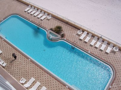 Islander Pool  - Our 80 foot (heated swimming pool in the winter)  is beachside! The deck also holds ample space for basking in the warm Florida sun. (NOT A VIEW FROM THE UNIT)