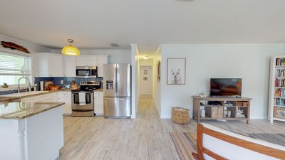 Open concept living, kitchen, and dining room for easy beach living!