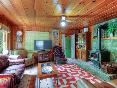 Photo for Cozy riverfront cabin w/river view, access & entertainment-dogs OK