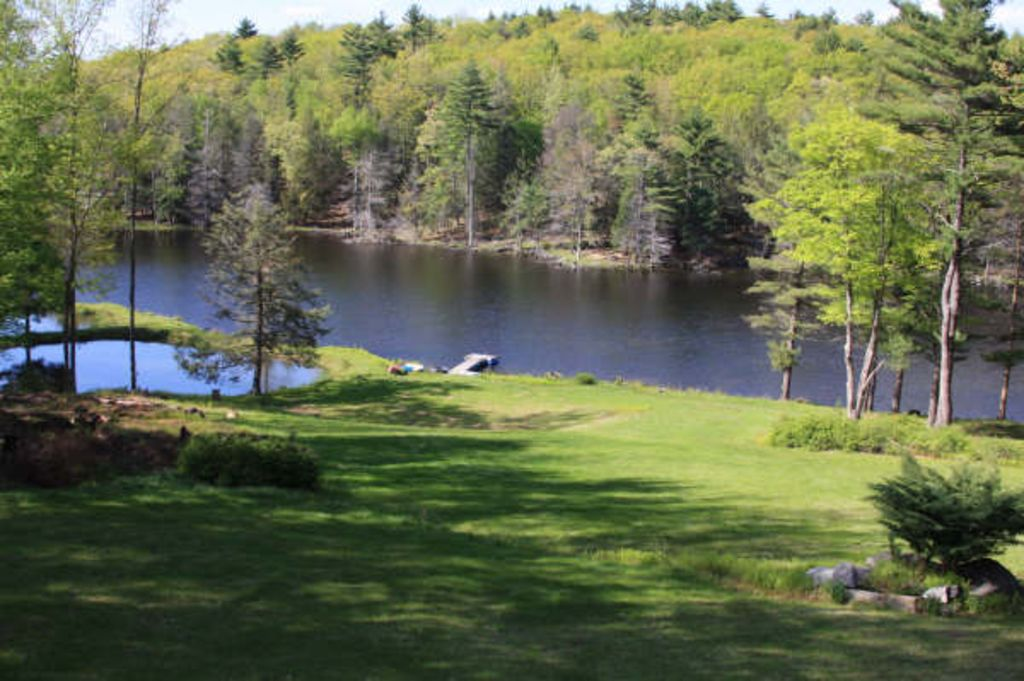 Rustic lakefront on 31 acres on its own lak vrbo for Pocono rental with private swimming pool