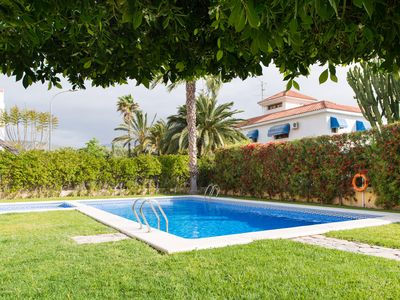 Photo for Luxury Townhouse, 2 Communal pools, Wi-Fi, Private garden- Walk to Beach & Town