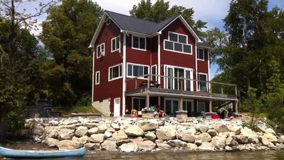 Photo for Spectacular Lakefront Home With Patio, Fire Pit, Dock and Tesla Charger.
