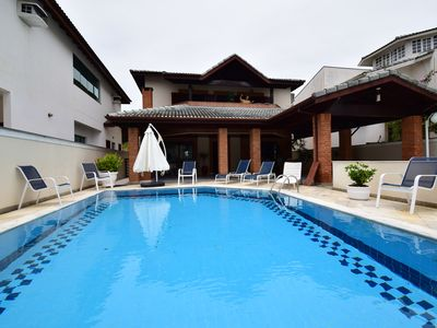 Photo for Beautiful house with 4 suites in closed condominium facing the sea and Peruíbe
