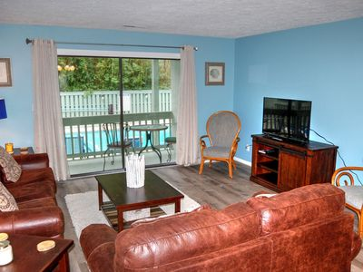 Darling condo overlooking pool less than one block to beach!