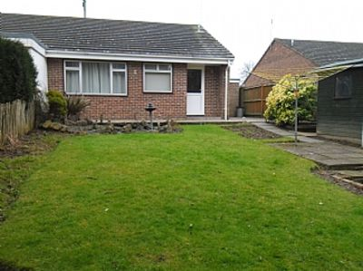Photo for Semi Detached Bungalow With Private Sunny Back Garden And Off Street Parking