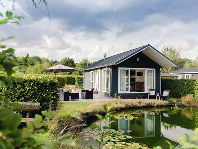 Photo for Comfortable chalet with a dishwasher, directly on a pond