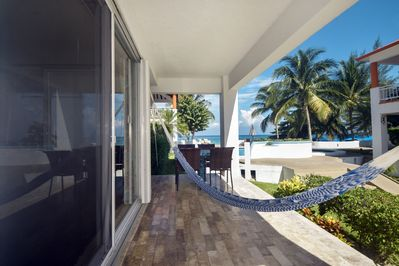 Our 1st floor patio overlooking pool and beach!