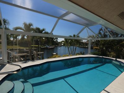 Photo for Pet Friendly Waterfront home with heated pool