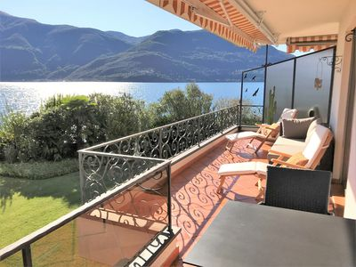 Photo for Apartment on the shores of Lake Maggiore, with large terrace and access to the l