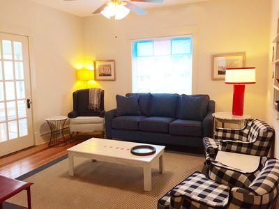 Living room with plenty of comfortable seating, large flat screen, dvd