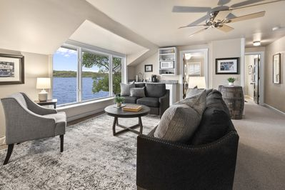 Enjoy the lake view from the family room with wet bar and coffee station.