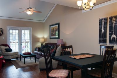open room with dining table, lots of seating
