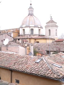 Photo for Welcoming apartment walking distance from Navona and Pantheon,view over roman roof, free wi-fi