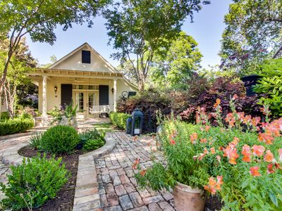 Photo for Charming cottage w/ beautiful patio & outdoor firepit - great downtown location