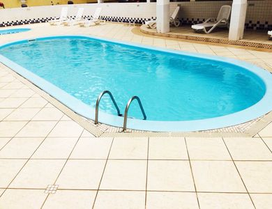 Photo for Apt to 50 meters sea, pool, games and balcony with barbecue! In the center!