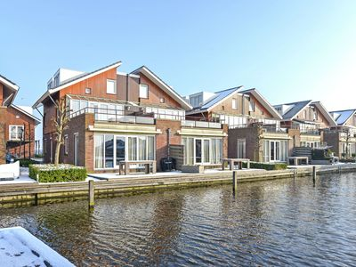 Photo for Modern, ground-floor, lakeside holiday home with terrace