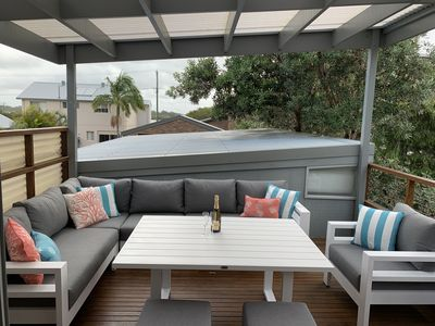 Covered private outdoor deck with super comfortable lounge and dining table.