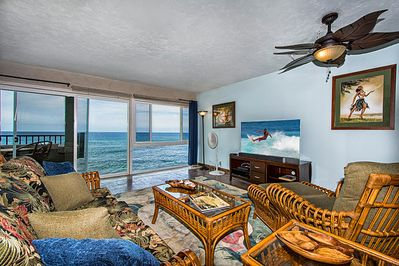 The living area featuring floor to ceiling glass,  the ocean is only a few feet away!