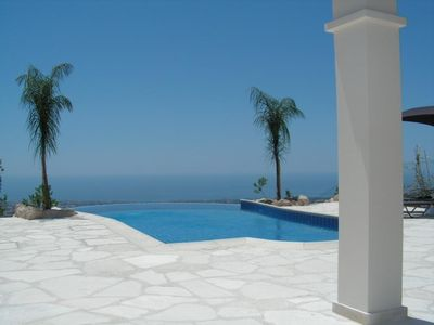 Panoramic sea view over the private infinity pool