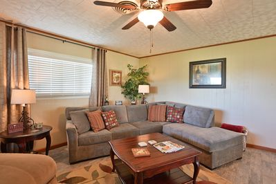 Cozy living area with plenty of seating for 8+ people