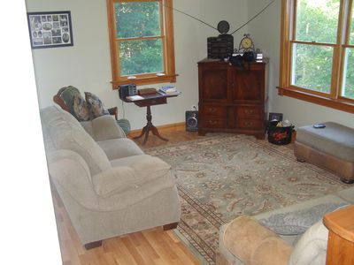 Family room offers great space: curl up with a book, hd, wifi, games, & hang out