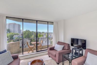 Living room with balcony access. - Living room with balcony access.