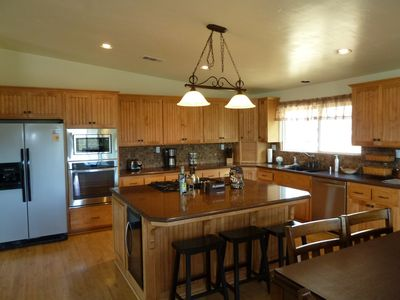 Custom Kitchen with Stainless  Appliances, Granite Counters and Wine Fridge