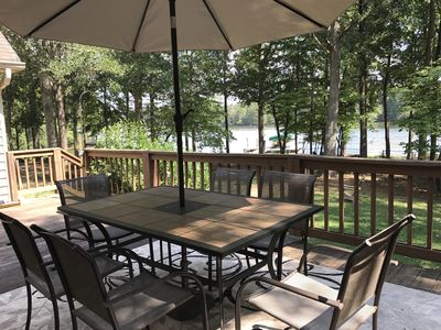 Dine on the lakeside deck with beautiful view of water and fenced yard.