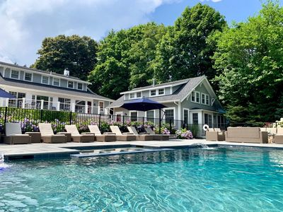 Masterfully restored mid-century estate featuring a heated pool, outdoor kitchen and fire-pit with a Main house, Carriage house and a Guest House.