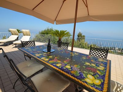 Photo for 3 bedroom Villa, sleeps 8 with Air Con, FREE WiFi and Walk to Shops