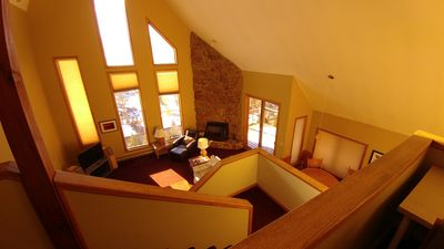 View of greatroom from landing at top of staircase to  master bedroom landing