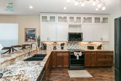 Kitchen - Fully remodeled kitchen will high-end appliances and full dining wares.