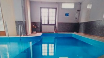 Photo for Lovely private apartment with  heated indoor pool set within large country house