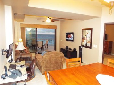 """Spacious living room includes 60"""" TV, Bluetooth stereo system, and computer desk"""