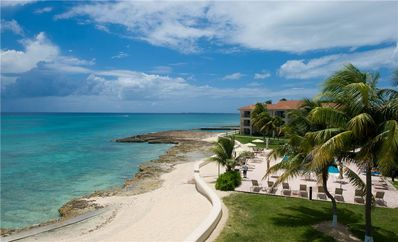 Photo for George Town Villas #318-Elegant Coastal Condo with Family-Friendly Perks near Seven Mile Beach